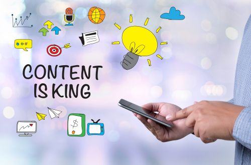 CONTENT IS KING concept person holding a smartphone on blurred cityscape background